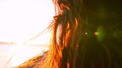 Beautiful Redhead near a bay at sunset Stock Footage