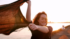 Beautiful Redhead near a bay at sunset - stock footage