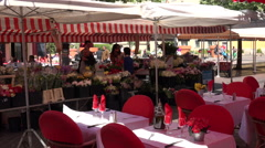 Open air restaurants at flower market in Cours Salaya old town, Nice, France Stock Footage