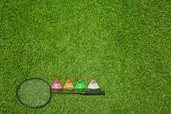 Badminton racket with color shuttlecocks - stock photo