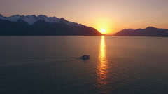 Motor Boat Cruising Past Sunset Reflection Alaska Sunbeam on Water HD Stock Footage