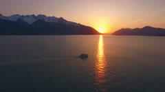 Motor Boat Cruising Past Sunset Reflection Alaska Sunbeam on Water HD Arkistovideo