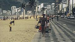 Rio de Janeiro 1977: people walking in Copacabana Stock Footage