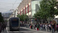 Tram drives down avenue jean medecin, Nice, France Stock Footage