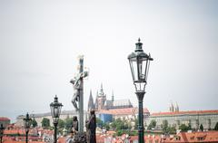 beautiful details of charles bridge with Prague castle on background - stock photo