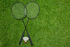 Crossed badminton rackets with shuttlecock Stock Photos