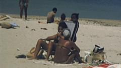 Rio de Janeiro 1977: people sunbathing in Copacabana Stock Footage