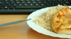 Dinner on table and computer keyboard Stock Footage
