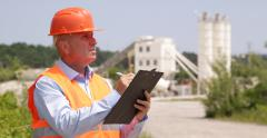 Concrete Pour Technology Engineer Calculate Clipboard Cement Tower Containers Stock Footage