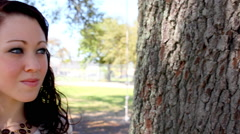 Beautiful dark-haired woman in a park Stock Footage