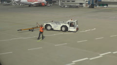 Tug ariplane vehicle after tow Stock Footage