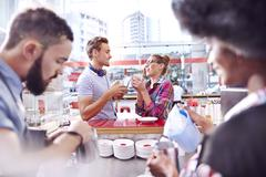 Couple talking and drinking coffee in cafe Stock Photos