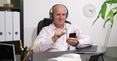 Office Entertainment Sales Agent Listen Music Smartphone Mp3 Player Headphones - stock footage