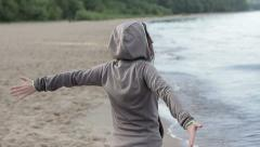 Young happy woman with arms wide open at the beach, slow motion HD Stock Footage