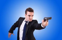 Businessman with gun isolated on white Kuvituskuvat