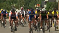 Cycle racers telephoto shot - stock footage