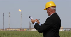 Oil Industry Business Man Notes Production Parameters Pollution Chemical Process Stock Footage