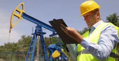 Engineer Write Clipboard Paper Oil Barrel Quantity Studying Extracting Process Stock Footage