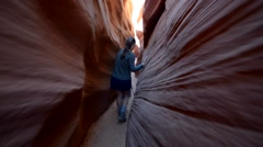 Girl Hiker Backpacker in the Slot Canyon Stock Footage