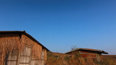 Vintage bamboo hut with blue sky, Pan shot Stock Footage