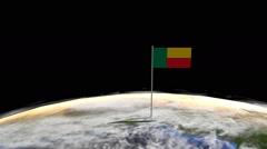 Benin flag on pole on earth globe animation Stock Footage