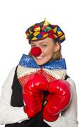 Pretty female clown with box gloves isolated on white - stock photo