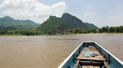 Sailing toward the Pak Ou cave in Laos Stock Footage