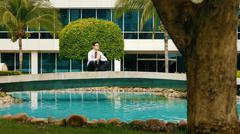 Businessman Meditating Doing Yoga Outside Office Building Stock Photos
