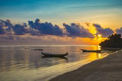 Sunset scene of  fisherman boat - stock photo
