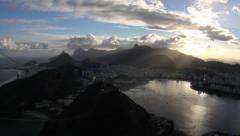 Time lapse christ the redeemer, bay, sunset light and sugar loaf Stock Footage
