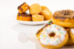 Different types of donuts and coffee - stock photo