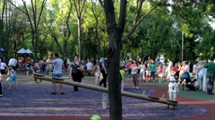 Park Full Of Kids And Parents On A Summer Afternoon, Kids Having Fun, Heat, Pan Stock Footage