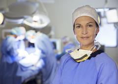Portrait of confident surgeon in operating room - stock photo