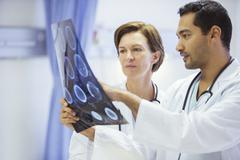 Stock Photo of Doctors reviewing and discussing MRI scans in hospital