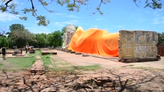 People come to Wat Lokayasutharam Temple for travel and pray Reclining Buddha Stock Footage