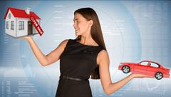 Smiling businesslady holding car and house Stock Photos
