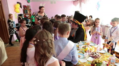 Animators are on children graduation day in kindergarten, kids party with meal Stock Footage