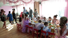 Children party in nursery at graduation day, table with snacks. Russian Stock Footage