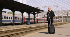 Business Person Suitcase Train Station Mobile Phone Talk International Departure Stock Footage