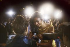 Celebrity signing autographs for fans at event Stock Photos