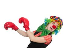 Female clown with box gloves  isolated on white Stock Photos