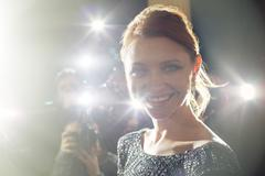 Close up portrait of smiling celebrity being photographed at paparazzi event Kuvituskuvat