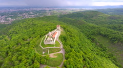 Aerial view of fort Medvedgrad with forest around it and cityscape in distance. Stock Footage