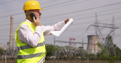 Thermal Power Plant Project Engineer Cellphone Talk Check Metal Structure Pillar - stock footage