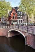 Canal Bridge and Houses in Amsterdam Stock Photos