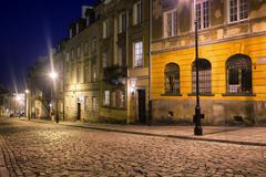 Cobbled Mostowa Street in Warsaw at Night - stock photo