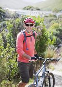 Mountain biker on dirt path Stock Photos