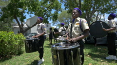 The drumline section of a marching band in Hollywood, Florida Stock Footage