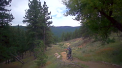 Aerial of mountain biker downhill trail Stock Footage
