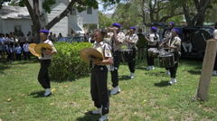Playing drums in the drumline section of a marching band in Florida Stock Footage